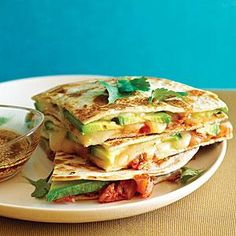 The spicy flavor of kimchi makes it a natural filling for quesadillas and a good contrast with mild, buttery avocado. You could also add grilled chicken or shrimp.