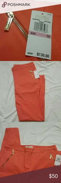 "NWT Michael Kors Hot Coral pants size 10 NWT Michael Kors Hot Coral pants with two cute gold zipper pockets, size 10. Retail $130.  Inseam 29""  P.S. I love to bundle. Just add items to a bundle and I'll send you a personal discount Michael Kors Pants"
