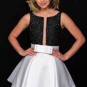 Stun the crowds in Jovani Style 47035. Available at WhatchamaCallit Boutique