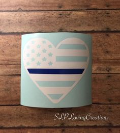 A personal favorite from my Etsy shop https://www.etsy.com/listing/286822717/blue-line-flag-heart-support-leo-car