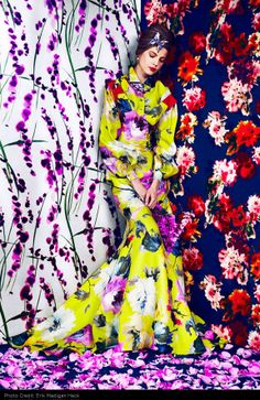 Harper's BAZAAR - PRINTS OF THE SEASON Layer on the florals at spring's graphic garden party PHOTOGRAPHS BY ERIK MADIGAN HECK; FASHION EDITOR: JOANNA HILLMAN   Carolina Herrera dress and blouse; Van Clef & Arpels brooch; Bulgari earrings, necklace, and brooch.