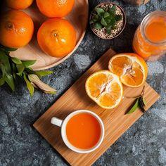 Fresh orange fruits and juice on marble table. Flat lay…