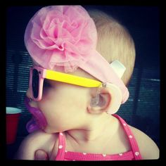 Rocking her shades and her matching pink Phonak hearing aids!
