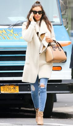 What did you say? Irina Shayk couldn't seem to turn her attention away from her cell phone as she was spotted out and about in New York City on Thursday