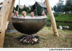 HUMAN STEW! Just kidding, it's an old fashioned hot tub! That is so awesome!