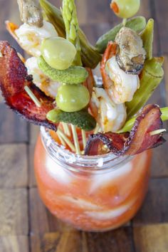 The Ultimate Bloody Mary {Seriously} light, citrusy, and slightly spicy topped with all the fixins! #recipe #bloodymary #cocktail #brunch