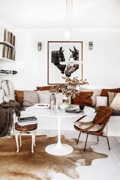 White and brown tones in dining room which doubles as a library.