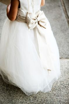I definitely want Layla to have a full tulle skirt with a striped black and white bow sash