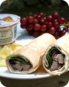 Easy lunch box ideas: whole-wheat tortilla smeared with cream cheese and wrapped around leftover barbecue pork ribs with mixed baby greens; grapes; yogurt; and potato chips. http://www.LunchBoxBlues.com