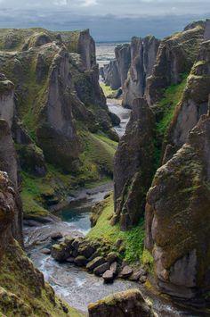 Canyon of Fjadrargljufur with the Fjaðrá river flowing through it. (Fjaðrárgljúfur in Icelandic) up to 100 meters deep and about 2 kilometres long located in SE Fjadrargljufur, Iceland.