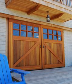 Real Carriage Doors is the leading manufacturer of wooden swinging doors and hardware. Browse our site today for outswing entry doors, garage doors, and more! Exterior Barn Doors, Shed Doors, Diy Door, Garage Style, Sliding Garage Doors, Garage Door Design, Garage Door Types, Doors, Sliding Doors Exterior
