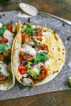 Tacos are stuffed with spicy shrimp, crumbled bacon, avocado, and tomatoes - then drizzled with a cool and creamy sour cream cilantro sauce. it's the perfect weeknight taco option! spicy shrimp tacos with sour cream cilantro sauce Shrimp Taco Sauce, Spicy Shrimp Tacos, Shrimp Taco Recipes, Mexican Food Recipes, Dinner Recipes, Shrimp Street Taco Recipe, Shrimp Wraps, Dinner Ideas, Dog Recipes