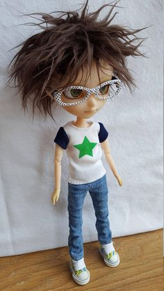 Cute white T-shirt with navy blue sleeves & green star on front. Shirt has been hand stitched by myself & is all ready to ship.