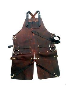 Leather apron with split leg and brass bull rings Welding Apron, Crea Cuir, Shop Apron, Men's Apron, Barber Apron, Work Aprons, Split Legs, Leather Apron, Aprons For Men