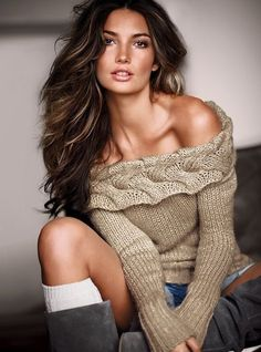 Dark brown with just a peek of highlights..like this hair color!  I like the sweater too:)
