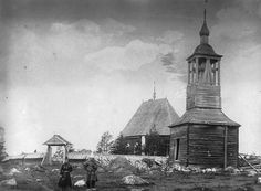 [Two+persons+in+Sami+dresses+outside+Jokkmokk+Old+Church+from+1753.+To+the+right+is+the+bell+tower.+public+domain+photo.jpg]