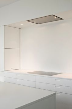Pure and sleek, white kitchen by Boffi_