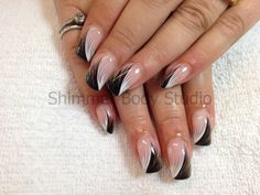 Gel nails, hand painted nails, black and white feather nails by Shimmer Body Studio.
