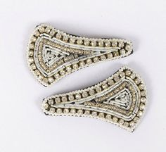 White thread edging with diamonds and gold beading embroidery in the center. Snap clip, diamantes, hand embroidered. White, Gold, Beading & Diamantes.  £8.00 on Etsy... Please click on the Etsy link to purchase.