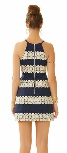 Lilly Pulitzer Annabelle Shift Dress shown in True Navy Annabelle Stripe. The navy blue and gold looks beautiful on sun kissed skin - just add your favorite jewels and gold shoes to complete the look.
