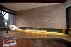 Contemporary Fireplace Designs : Modern Fireplace Design With Brick Wall And White Chair With Small Table In Contemporary House Minimalist Fireplace, Linear Fireplace, Fireplace Wall, Fireplace Design, Fireplace Ideas, Brick Wall, Stone Fireplaces, Minimalist Living, Interior And Exterior