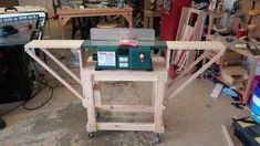 Benchtop jointer stand with folding extension wings