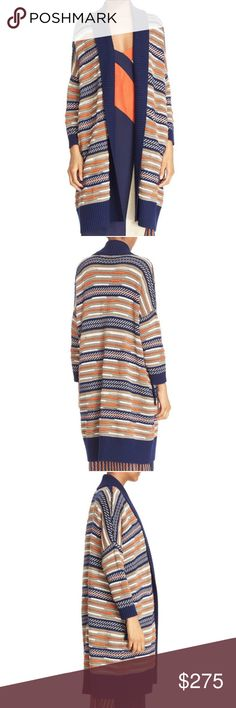 """New DVF Taletha Open Front Long Cardigan Sweater Size - L  This new blue, orange, beige and white Taletha oversized cardigan sweater form DVF Diane Von Furstenberg features:  Cheery color and textured patterning add statement-making style to this longline shawl-collar cardigan knit from a cozy-soft merino-wool blend with relaxed drop-shoulder design.      35"""" length (size Large).     No closure.     Open shawl collar.     Side-seam pockets.     41% merino wool, 34% cotton, 11% silk, 7%…"""