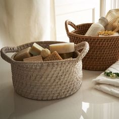 Modern Weave Round Baskets  CAD15.03    3 baskets in entry...all toques, scarves and third basket holds gloves.  Storage items rotate with the seasons.  Can sit on console, storage under bench or on shelf above console and under mirror....