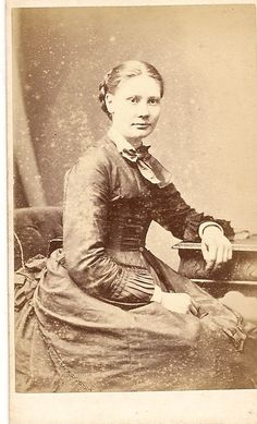 91.Young Lady sitting. Photographer is H.V.Lemenager, 16 High Street, Watford, Hertfordshire. Henri Victor Lemenager was born in Paris, France bet 1832/9. Watford in 1861 a teacher, Prof French. 27th Dec 1861 he m Mary Jane Braden. 1871 a Photographer in Watford, and Ph in 1881. Had 2 d'ters & 4 sons. By 1891 he & family gone from our records. But articles written by a Henri Victor Lemenager in US Newspapers, looks like they emigrated & became a reporter,