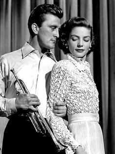 """Kirk Douglas, Lauren Bacall in """"Young Man with a Horn"""" (1950)."""