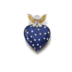 LAPIS LAZULI AND DIAMOND BROOCH, VERDURA. Set with a lapis lazuli heart accented with brilliant-cut diamonds, surmounted with a gold angel motif embellished with similarly-cut diamonds, signed Verdura, also fitted with pendant loop.
