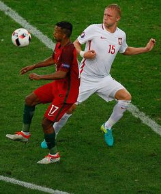 Kamil Glik of Poland in action against Nani of Portugal during the Euro 2016 quarterfinal football match between Poland and Portugal at the Stade. Portugal Euro 2016, 2016 Pictures, World Football, European Championships, Football Match, Poland, Action, Sports, Hs Sports