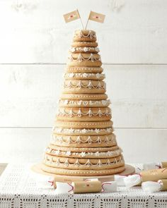 Kransekake: Norway & Denmark celebration cake of layered rings of crisp cake made from almond, egg white and sugar layered with decorative icing.
