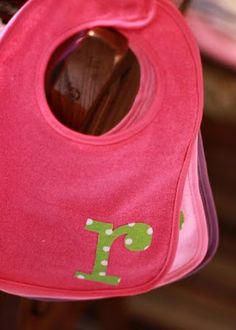 Personalize bibs by using the cricut to cut fabric! I really need to break out my cricut!