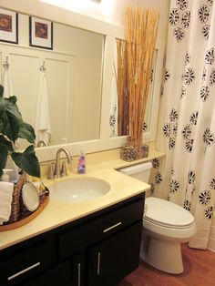 Clever way to frame and divide a large boring mirror.  I have one of these in my bathroom that could benefit from this trick.