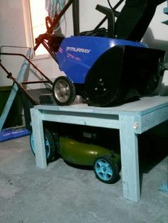 Lawn Mower/Snowblower storage. A great way to make some floor space when not using your snowblower during off season. http://egardeningtools.com/product-category/snow-removal/