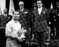 Vittorio Marzotto with Prince Rainier III and Antony Noghès - the winner in the 1952 Monaco Grand Prix driving a Ferrari.