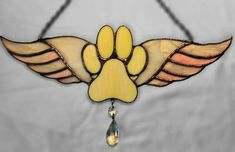 Xtra large Stained glass yellow paw print with angel wings.