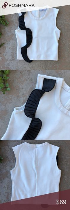 Opening Ceremony White Asymmetrical Crop Top Sleeveless fitted crop top with black detailing along the side by Opening Ceremony. In excellent condition, no flaws. Size XS. Opening Ceremony Tops Crop Tops