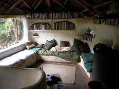 Occasionally I have uber-hippy fantasies of living in one of these cob houses, with all-solar power and recycled water and all that. But then I remember they're always in the desert and you just couldn't pay me enough. But hey, this one has books!