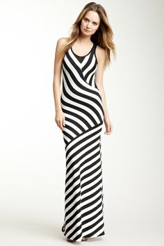 """Long Crew Stripe Print Dress by Go Couture   About This Item  - Scoop neck  - Sleeveless  - Racerback  - Stripe print throughout  - Topstitch detail  - Approx. 61"""" length  - Made in USA  Additional Information  Fit: this style fits true to size.    Model's stats for sizing:  - Height: 5'8.5""""   - Bust: 32""""  - Waist: 24""""  - Hips: 34""""  Model is wearing size S.  Care Info  Machine wash  Fiber Content  90% rayon 10% spandex  $158"""