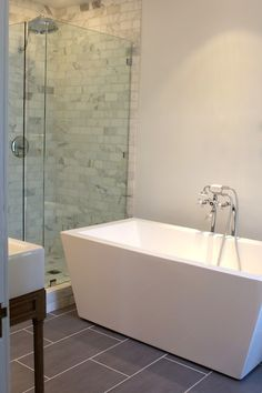 Kishani Perera: Stunning master bath with glass shower enclosure filled with marble subway tile shower ...