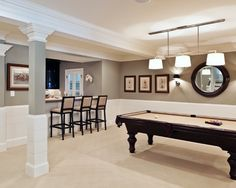 Nice neutrals make the basement look larger