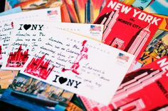 Invitations on NYC postcards, embossed with stamps.