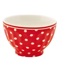 Red and white polka dot French bowl. The bowl features an elegant white spot pattern set against a vibrant red background with a subtle white border rim. This piece cleverly combines bold colours that ensure the piece will make an eye-catching addition. Use the bowl to serve snacks to guests or for pouring a warm bowl of soup to beat off the chill. It will make a great addition to the tableware collection in your home. Combine this piece with other key products from the GreenGate collection…
