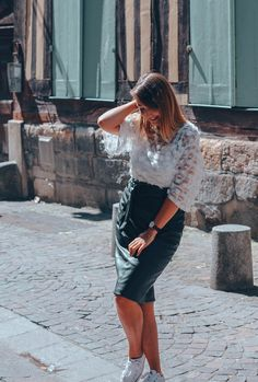 Street style in a pretty leather skirt in Rouen, France
