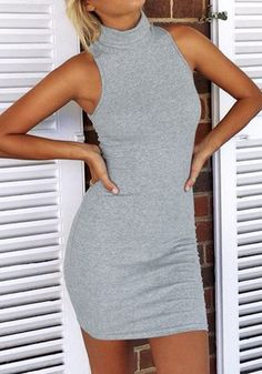 Front view of model in grey sleeveless turtleneck dress