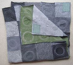 the quilting on this looks like it would be a lot of fun, salvaged sweaters!