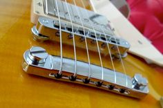 Top wrapping the strings on a Les Paul tailpiece.
