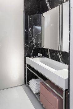 Modern bathroom with a Nero Marquina marble wall. Don't over think it